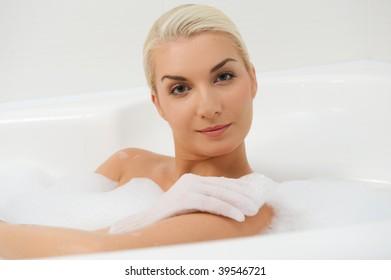 Young woman washing in bathroom