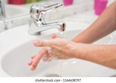 Young woman washing her hands
