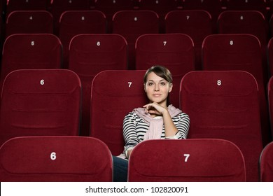 Young woman watching a movie alone