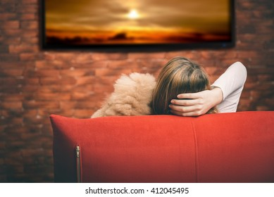 Young woman watching smart TV.