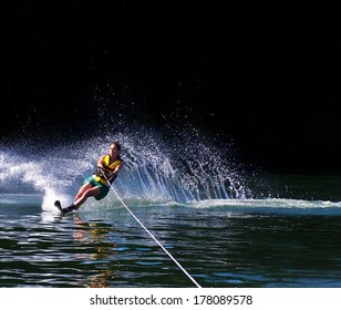 a young woman water skiing on a lake