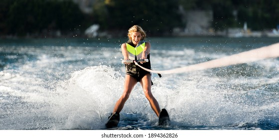 young woman water skiing on a sea