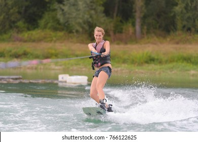 young woman waterskiing