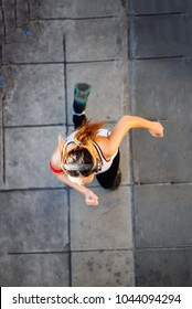Young woman wear sport shoes running on pavement, top view, healthy care concept.