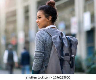 Young woman wearing backpack in city