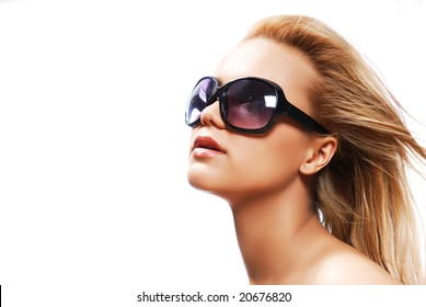 Young woman wearing the big modern sunglasses. Studio shot on a white background