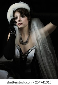 Young woman wearing black and white gown with rhinestones and black gloves
