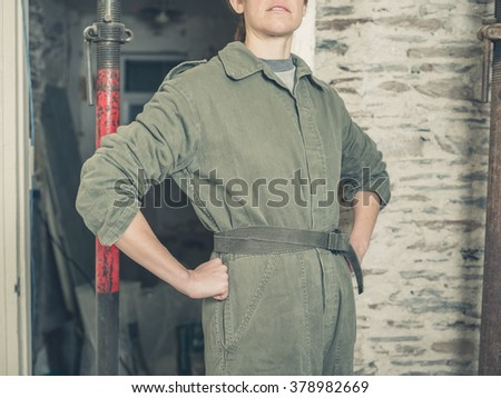 Young Woman Wearing Boiler Suit Standing Stock Photo Edit Now