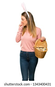 Young woman wearing bunny ears for Easter holidays is suffering with cough and feeling bad on isolated white background