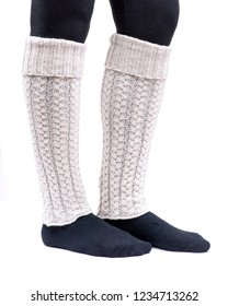 Young woman wearing cable knit leg warmers ivory color isolated on white background