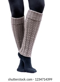 Young woman wearing cable knit leg warmers taupe color isolated on white background