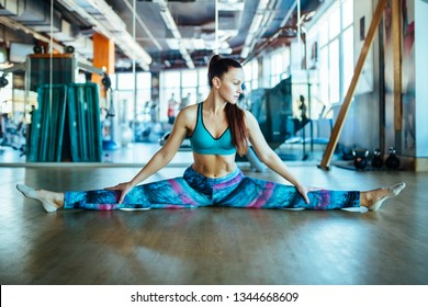 Young woman wearing a crop top doing stretching exercise