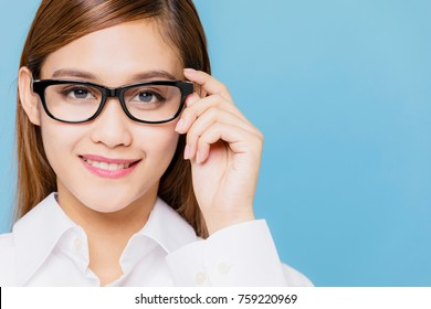 Young woman wearing eyeglasses.