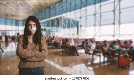 Young woman wearing face mask for protection inside airport due to Covid-19 Corona virus.