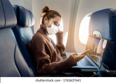 A young woman wearing face mask is traveling on airplane , New normal travel after covid-19 pandemic concept  - Shutterstock ID 1763637641