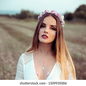 Young woman wearing flower crown in nature