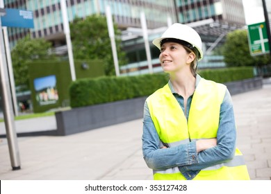 young woman wearing a hard hat and yellow jacket