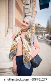 young woman wearing hijab walking