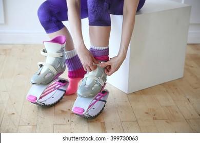young woman wearing kangoo jumps boots