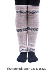 Young woman wearing lemon Fair Isle leg warmers isolated on white background