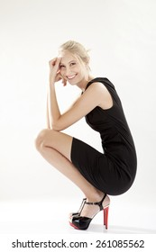 Young woman wearing little black dress, LBD