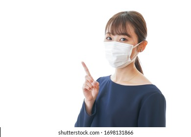 Young woman wearing a mask pointing something