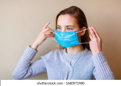 Young woman wearing medical face mask to protect herself from pollution, germs and coronavirus during quarantine. Corona virus, covid -19, pandemic protection concept.