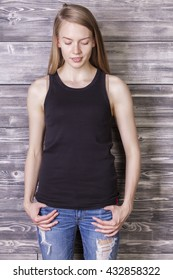 Young woman wearing plain black tank top. Mock up