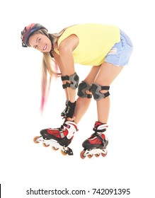 Young woman wearing roller skates against white background