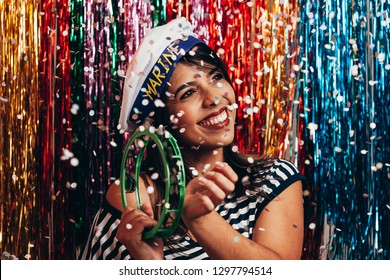 Young woman wearing sailor costume celebrating the carnival party