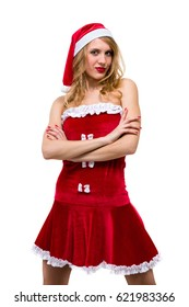 Young woman wearing santa claus clothes posing against isolated white background