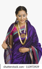 Young woman wearing sari and smiling