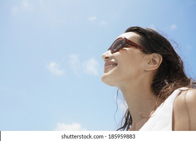 Young woman wearing sunglasses (low angle view)