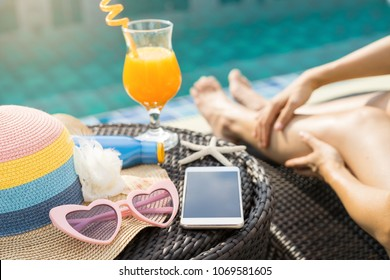 Young woman wearing swimsuit relaxing at swimming pool, Summer vacation concept