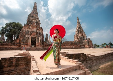 Young woman is wearing Thai clothes in old temple at Ayutthaya Thailand.