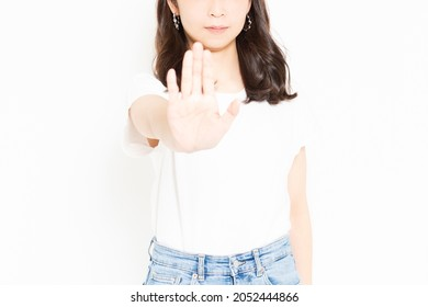 Young woman wearing a T-shirt showing NG sign