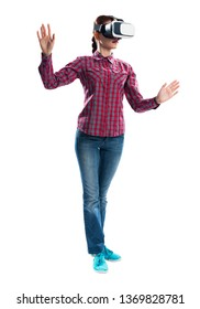 Young woman wearing VR goggles and gesturing in virtual reality. Woman standing and touching air during using VR headset. Studio photo by front view girl against gray background. Cyber technology