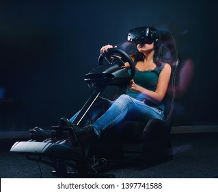Young woman wearing VR headset driving on car racing simulator cockpit with seat and wheel.