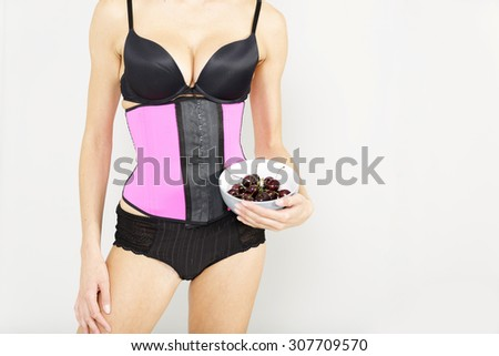fcea763df6 Young woman wearing a waist training corset in black underwear which is the  new craze for