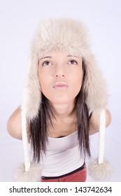 young woman wearing winter cap, kissing