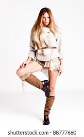 young woman wearing winter clothes, full body shot, studio shot