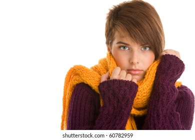 Young woman wearing woolly scarf and sweater isolated on white background