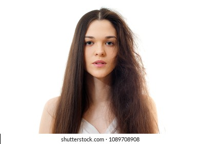 Young woman with well-groomed combed and problem unkempt hair. White background close up