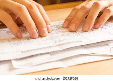 A young woman while sorting her old receipts