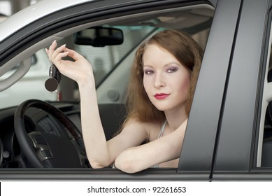 Young woman in the white car