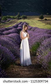 Young woman in a white dress in a lavender field