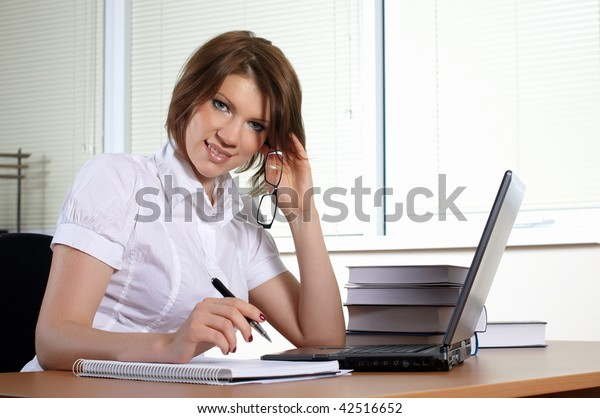 young woman in white dress in office
