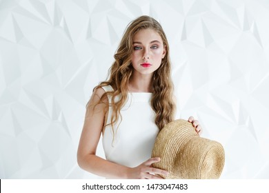 Young woman in white giving a straightforward ironic look