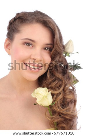 Young woman with white rose on white