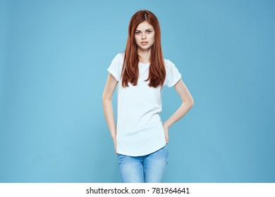 young woman in a white T-shirt on a blue background, studio, logo